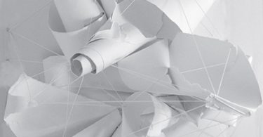 Rolled and crumpled whtie paper tied together with white string.