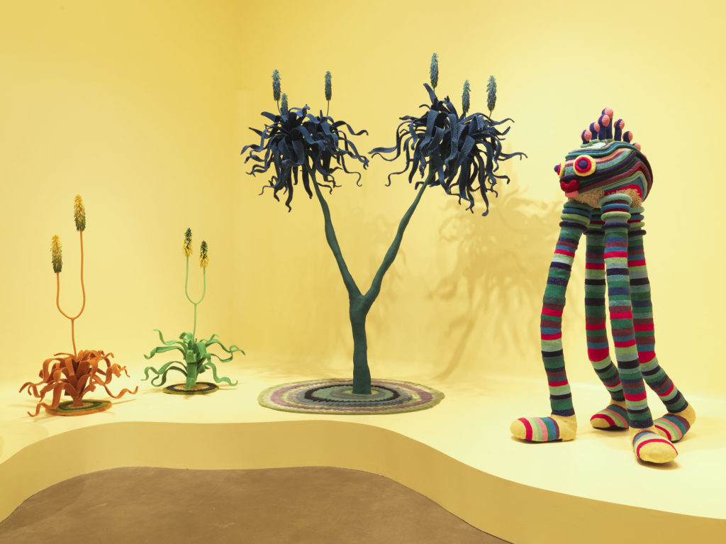 sculptures of fantasyland flora and fauna made with a variety of materials including colorful glass beadwork