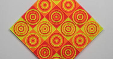Many multi-colored concentric circles on a titled diamond-shaped canvas.