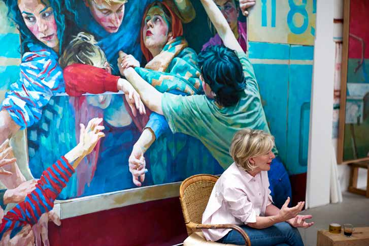Xenia Hausner talking in front of her painting representing a group of people