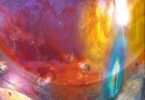 Abstract painting - very brightly colored celestial-like imagery with fragments floating