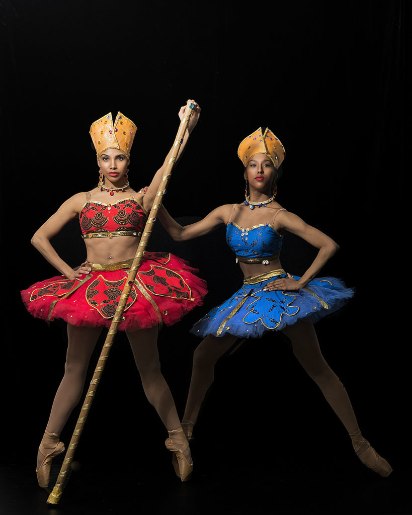 2 Hiplet ballerinas on point.  One in red and the other in blue