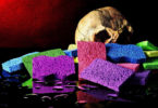 "A skull on a pile of colored sponges. The image reads ""Room for thought: Are all the tears of the world enough?"""