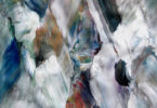 Abstract work of white, blue, black and mixed colors of brushes of paint that look like waterfalls at all different angles.
