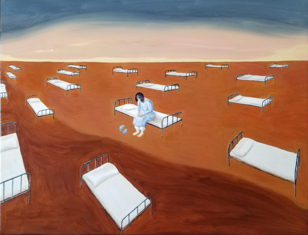 surrealist image of a field of metal framed beds spaced apart for social distancing.  One figure sits on a bed in the center of the image, with head bowed, and hand clasped, bare feet and two blue items next to the feet. the figure is wearing white pants and a blue coverall.