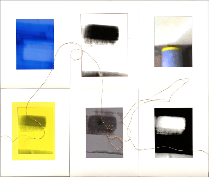 An abstract grid of four vertical rectangles with blue, yellow, black, grey and white colors.