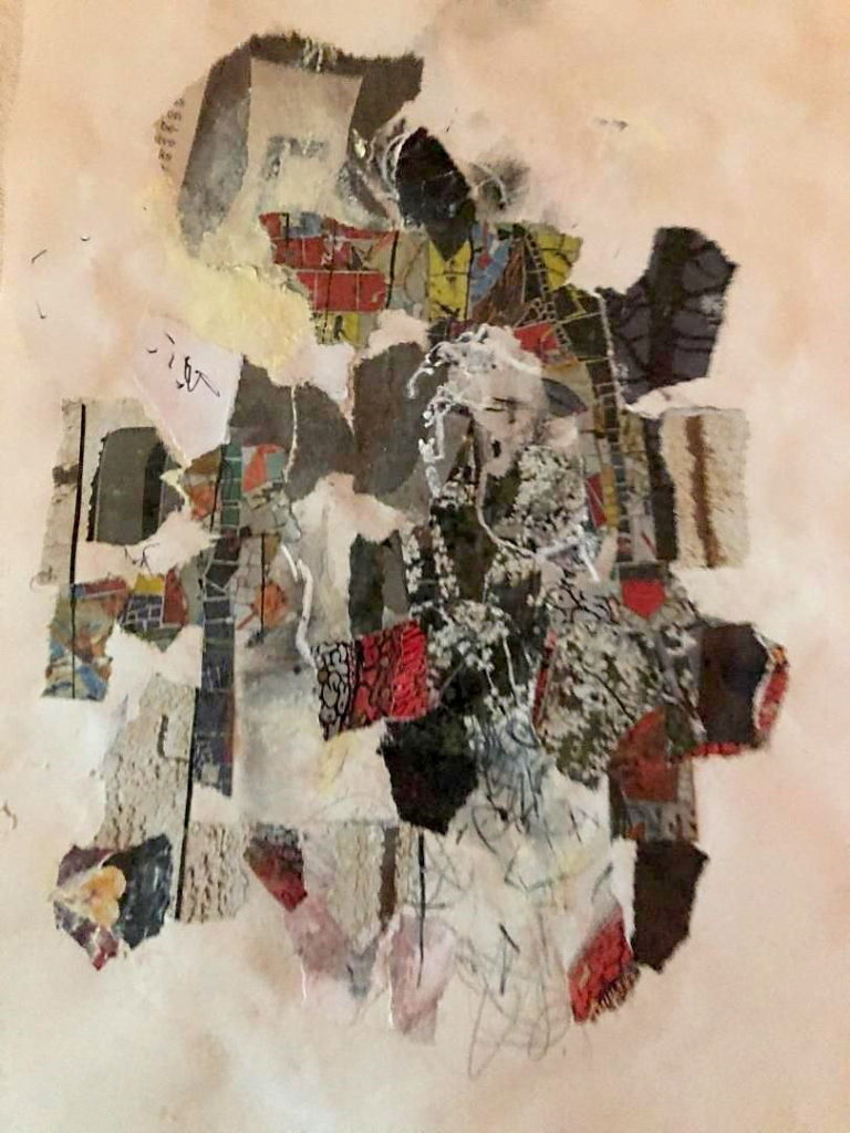 abstract textural collage on a white background.  Multi-colored with strong reds, grey, brown predominating