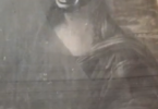 a black and white image of the Mona Lisa with Vernita Nemec's face superimposed on the famous imagee