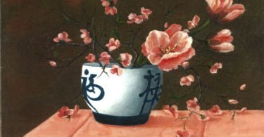 Painting of pink flowers in a blue and white bowl with Chinese-like characters drawn on the bowl, on a tablecloth.