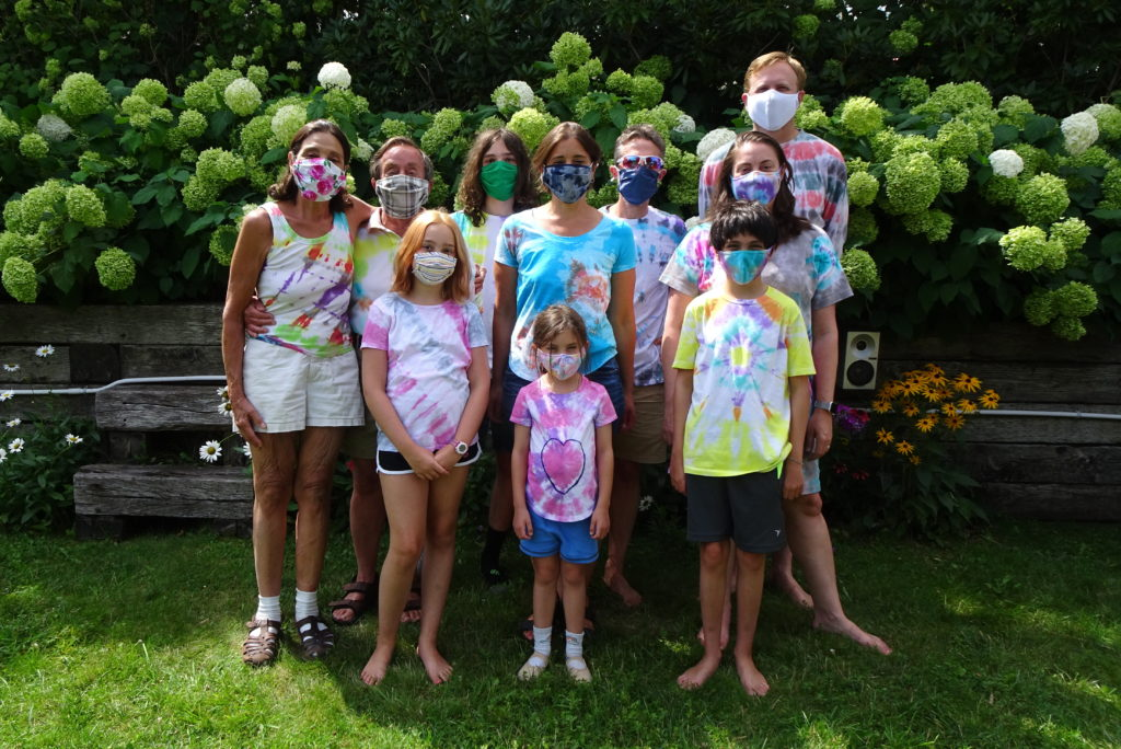 Family portrait in the garden with all wearing masks