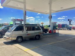 photo of the Toyota van at a gas station
