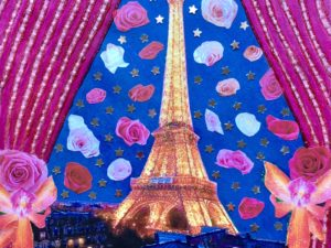 Eiffel tower with collaged roses and stars surrounding it.