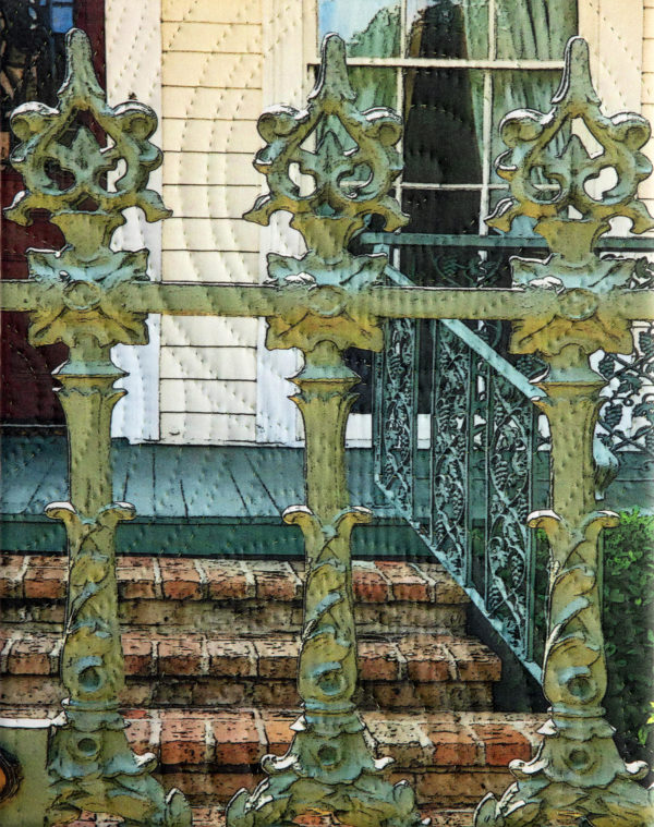 Cast iron fence with house in the background. There are radial overlays on the image.