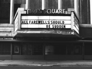 "Empty street with the Times Square sign reading, ""All Farewells Should be Sudden."""