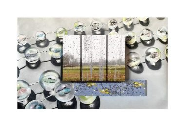 Images of clear balls on a chain, behind a window in the center of a rain soaked paddock and another image of rain on a mirror like surface