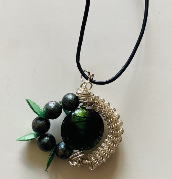 Photograph of rope necklace with a bead pendant