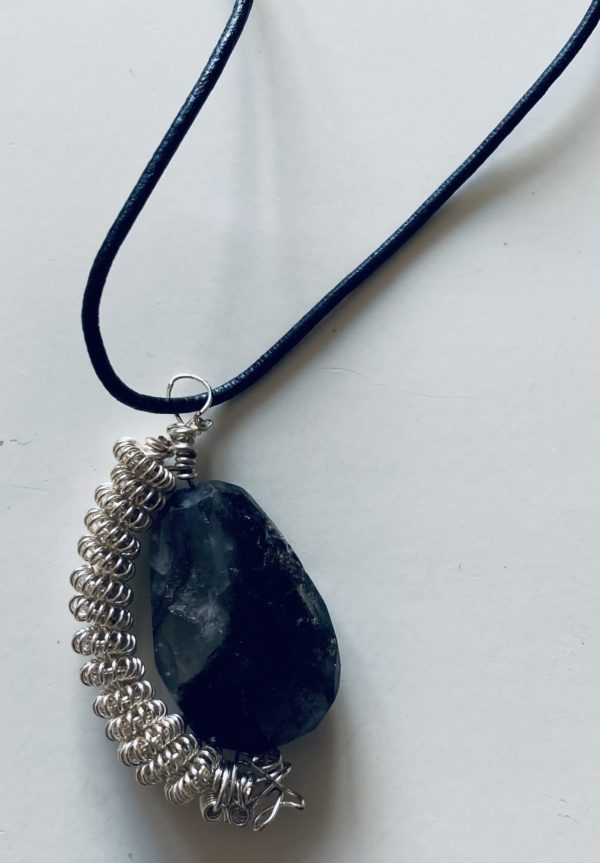 Photograph of leather strip necklace with a large bead and spiral