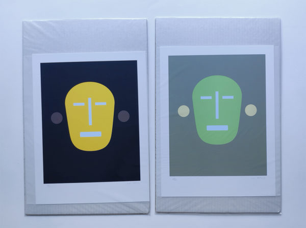 mask like image of a face in yellow and green - prints packaged