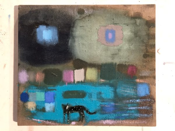 a small black cat in the center front of an abstract landscape largely painted in blue grey and black