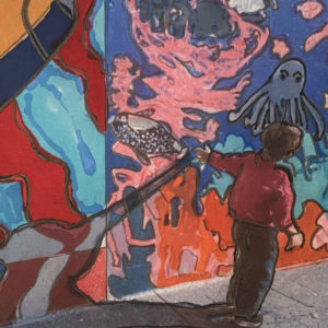 painting of a child walking along a sidewalk trailing a hand along the wall covered in a mural