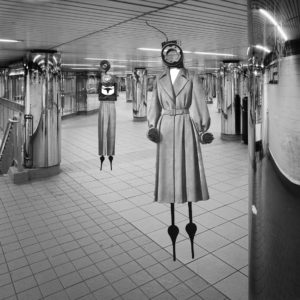 digital work with a photograph of a subway corridor with expressionist figures with stick legs