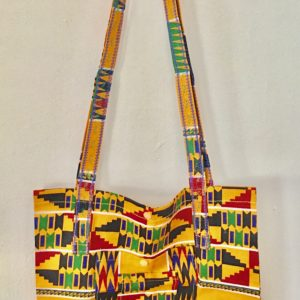medium sized handmade cotton tote with orange African geometric designs with long shoulder straps